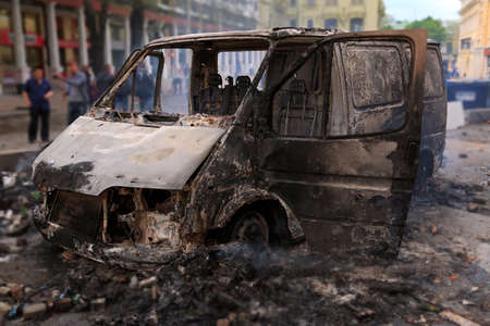 riot: Burned car in the center of city after unrest in Odesa, Ukraine