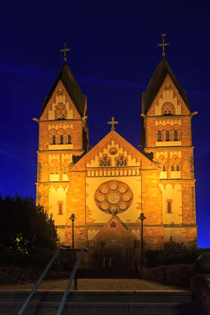 saar: St. Lutwinus church in Mettlach at night, Germany Stock Photo