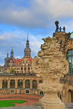 Closeup stone figure and Residenzschloss (city hall) on the back at Zwinger palace in Dresden, Germany