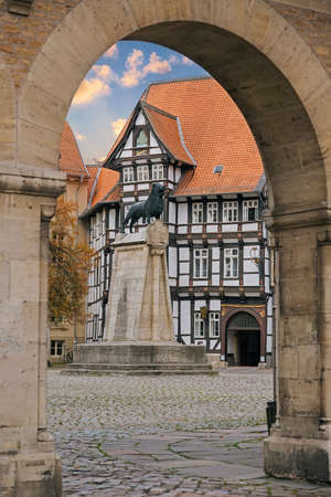 Lion statue and old timbered house in Braunschweig patio, Germany