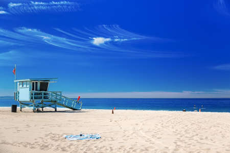 Lifeguard station with american flag on Hermosa beach, California, USA