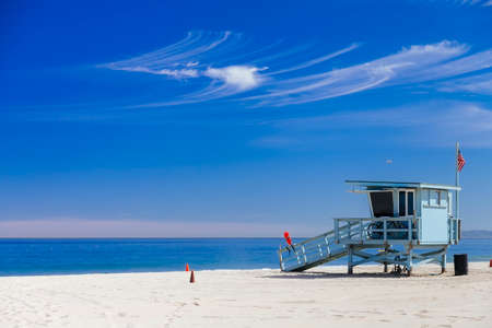 los: Lifeguard station with american flag on Hermosa beach. Stock Photo