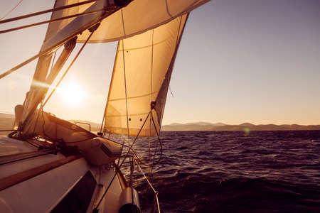 Sailboat crop during the regatta at sunset ocean, instagram toning