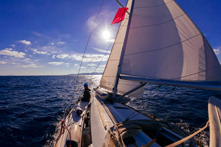 Sailing boat wide angle view in the sea at sunset, instagram toning