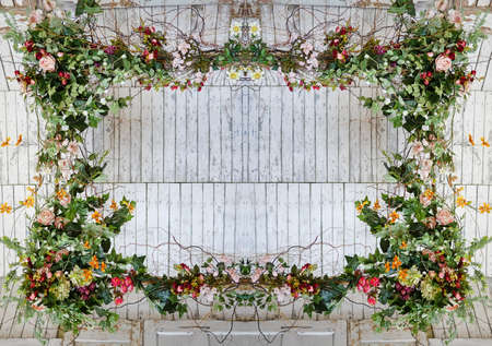 Vintage frame made from flowers, leaves with the grunge wooden background