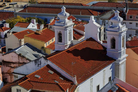 districts: Igreja de Santo Estevao in Lisbon and house roofs, Portugal
