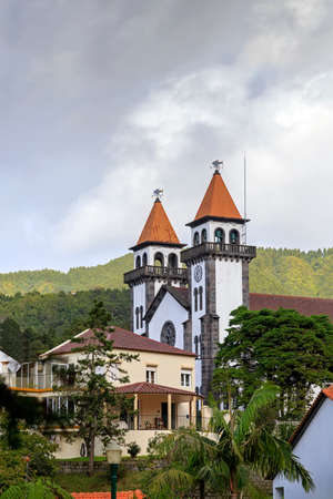 senhora: Church of Nossa Senhora da Alegria in Furnas with cloudy sky, Azores