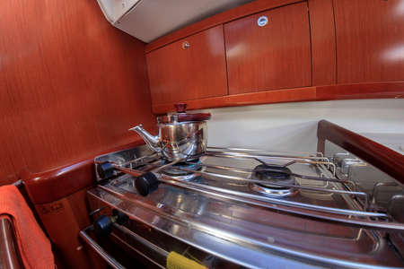 caboose: Kettle on gas  stove at yacht kitchen Stock Photo