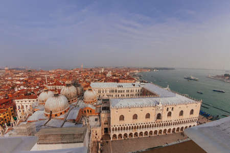 San Marco Basilica domes, Doges Palace and roofs of venetian houses, top view Redactioneel