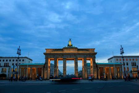 Brandenburg gates in Berlin with crowd and urban transport