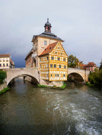 Obere bridge (br?cke) and Altes Rathaus and cloudy sky in Bamberg, Germany