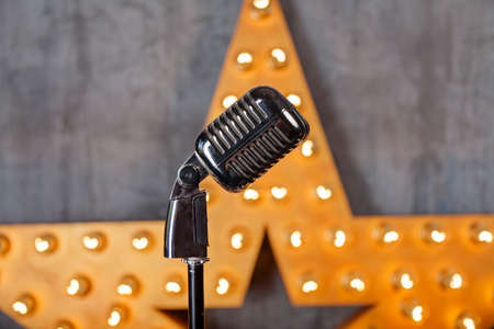 Vintage microphone in studio with star on background Stockfoto