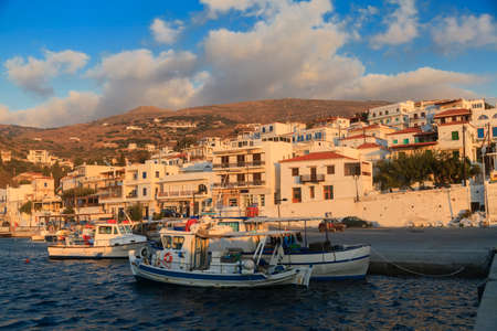 Fishing boats in the bay of greek village at sunrise