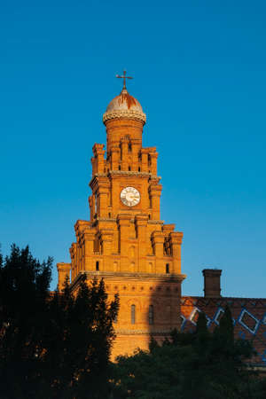 univercity: Clock tower made from brown bricks of Chernivtsi State Univercity, Ukraine