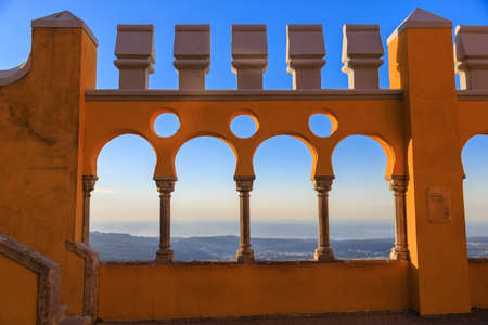 Pena castle yellow arch at sunset in Sintra, Portugal Redactioneel