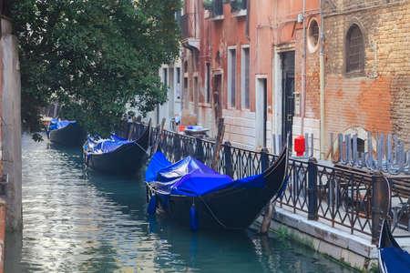 Venetian gondolas in narrow channel, Venice, Italy