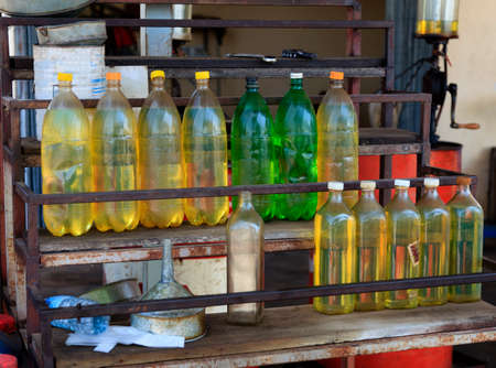 Plastic bottles with fuel on cambodian petrol station