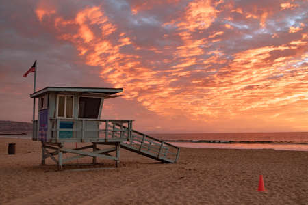 baywatch: Lifeguard station with american flag on Hermosa beach at sunset, California, USA Stock Photo