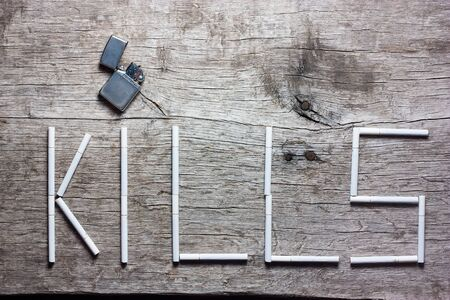 killing cancer: Smoking kills (conceptual inscription paved cigarettes with lighter - kill)