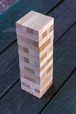 game block: Wooden game block standing on a wooden table