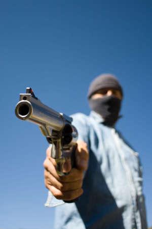 Hooded man with 44 magnum handgun revolver photo