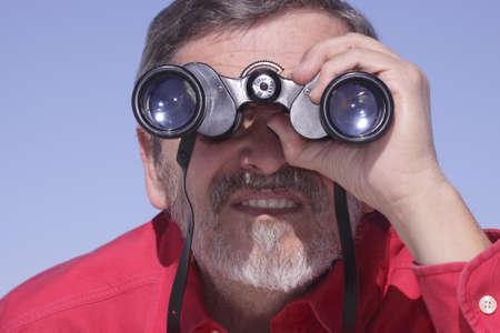 Man searching with Binoculars photo