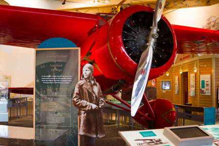 WASHINGTON D.C., USA - MAY 11, 2016: Amelia Earhart and red Lockheed 5B Vega First woman to attempt to circumnavigate the Globe, National Air and Space Museum in Washington D.C. Smithsonian Institution