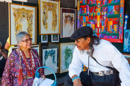 SANTA FE, NEW MEXICO, USA - AUGUST 18, 2013: Santa Fe Indian Market, artists at the Annual Event Editorial