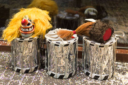 fasnacht: Three snare drums with masks laying on top during the basel carnival in front of the window of a shop. Picture taken on 15th of February 2016 in Basel, Switzerland Editorial