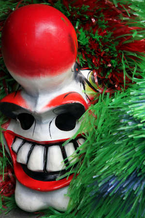 Closeup of a single red green waggis mask during the basel carnival Stock Photo