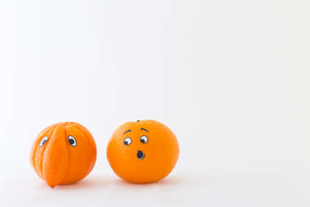 embarrassment: Fresh oranges with funny faces in front of white background. One orange has a huge nose Stock Photo