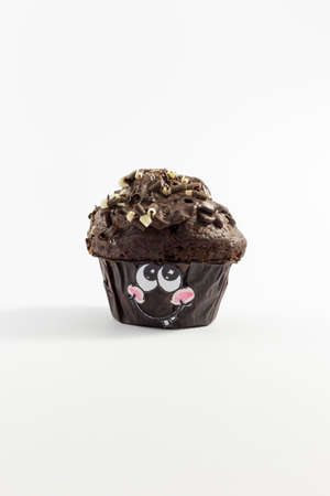 irresistible: A fresh and sweet chocolate muffin with cute cartoon style face on white background