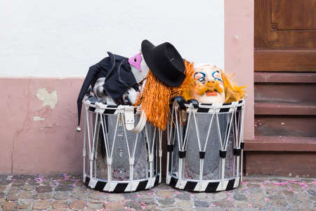 Basel carnival. Nadelberg, Basel, Switzerland - March 7, 2017. Two snare drums and carnival masks are waiting for their owners on the side of the street.