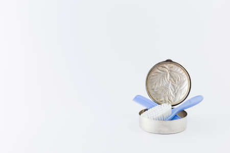 princely: Baby boy luxurious items collection isolated on white background. Comb and hairbrush in a silver can.
