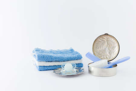 Baby boy luxurious items collection isolated on white background. Comb, hairbrush, pacifier with luxurious silver items and towels.