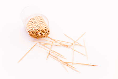 Wooden toothpicks in a transparent plastic container on white background Reklamní fotografie - 87957205