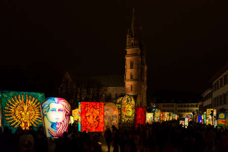 Muensterplatz, Basel, Switzerland - February 20th, 2018. Basel carnival. Beautiful illuminated lanterns in front of the Basel minster