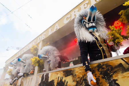 Basel carnival. Steinenberg, Basel, Switzerland - February 21st, 2018. Close-up waggis clowns on their carnival float.