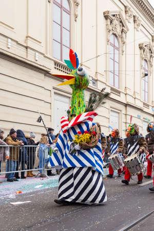 Basel carnival. Steinenberg, Basel, Switzerland - February 21st, 2018. Carnival group leader in a creative bird costume.