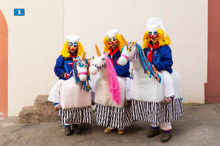 Basel carnival. Schluesselberg, Basel, Switzerland - February 21st, 2018. Portrait of three participants in cute horse costumes