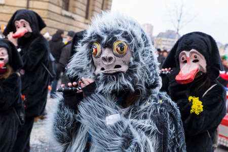 Basel carnival. Schifflaende, Basel, Switzerland - February 21st, 2018. Close-up of a flute playing carnival reveler