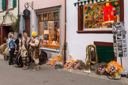 Basel carnival. Nadelberg, Basel, Switzerland - February 21st, 2018. Carnival revelers having a break in the old town