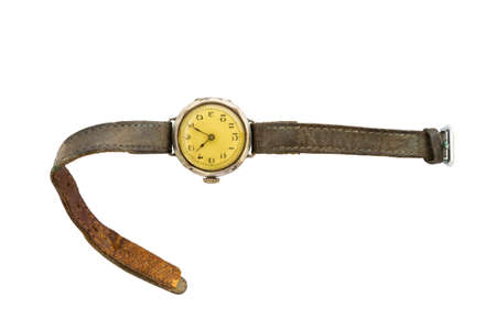 Closeup of a retro style yellow colored wristwatch with worn leather straps isolated on white background.