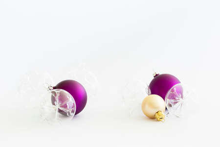 Still life with beautiful decorative transparent and purple christmas glass balls on white background Stock Photo