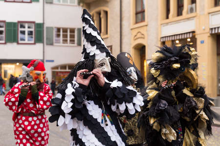 Basel carnival. Nadelberg, Basel, Switzerland - February 21st, 2018. Close-up of a beautiful black and white clown costume Editorial