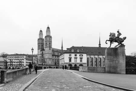 Switzerland, Zurich. Black and white picture of the Grossmuenster church and the Muenster bridge in the old town during a foggy autumn day. Picture taken on 4th of November 2018