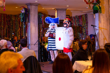 Basel, Switzerland - March 11th, 2019. A group of carnival Schnitzelbaenggler performing their parody poetry in a restaurant Redakční