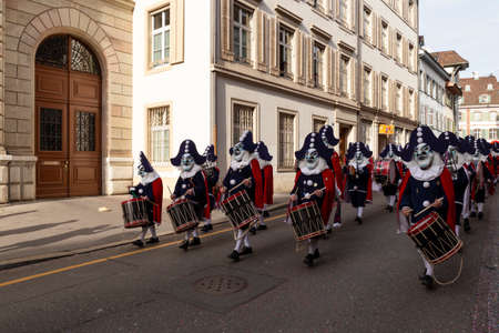 Baeumleingasse, Basel, Switzerland - March 12th, 2019. Carnival marching group with snare drums Redakční