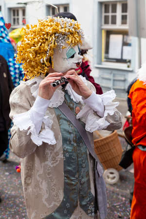 Baeumleingasse, Basel, Switzerland - March 12th, 2019. Close-up of a disguised carnival piccolo player Redakční