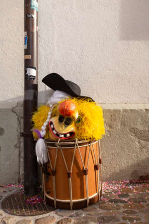 Muensterberg, Basel, Switzerland - March 12th, 2019. Close-up of a snare drum with a carnival mask on top Redakční